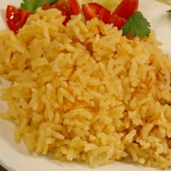 Mexican Tomato-Flavored Rice Recipe - Make light and fluffy tomato-accented rice flavored with onion and garlic powders using this hand-me-down recipe.