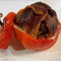 Ryan's Stuffed Green Peppers Recipe - Line the inside of bell peppers with bacon and fill with a mixture of rice, ground beef, ketchup, and barbeque sauce for a fun spin on stuffed peppers.