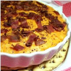 Sweet Potato Casserole with Bacon Recipe - Bacon makes a great topping instead of marshmallows for this Thanksgiving family favorite!
