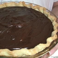 Double Chocolate Pie Recipe - There 's chocolate chips, squares of unsweetened chocolate, and lots of eggs and milk in this creamy, rich pie. The filling is cooked up until thick and lovely and poured into a baked pie shell. It can be made two days in advance.