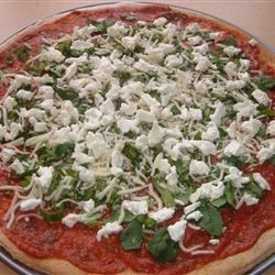Basil Goat Cheese Pizza Recipe - Basil, rosemary, and goat cheese flavor this vegetarian pizza made with frozen bread dough.  This is among my husband's favorite dinners!   The flavors compliment each other so well and it is so easy!  I use frozen bread dough to speed the process.