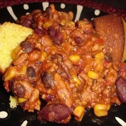 Slow-Cooked Habanero Chili Recipe - Black-eyed peas, corn and dried habanero chilies give this turkey chili extra personality. Serve topped with shredded Cheddar cheese or crumbled cornbread.