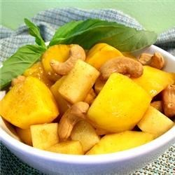 Mango Cashew Salad Recipe - Succulent mangoes are a refreshing warm weather favorite! Apples, cashews, and spices make this salad a real winner.