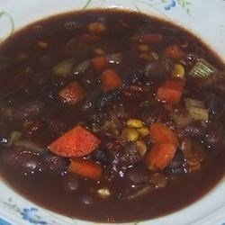 Heddy's Black and Red Bean Soup Recipe - A yummy soup that even picky kids will love! Red beans and black beans are mildly seasoned and simmered in vegetable broth. With these ingredients this is a healthy vegetarian soup with a complete protein. If you add the chili powder, leave out the maple syrup. It totally changes the taste. Garnish with sour cream, green onions and tortilla chips for a festive meal. This is great served with cornbread.
