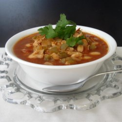 Chicken and White Bean Chili Recipe - This white bean chili recipe features chicken and cannellini beans in chicken broth, with jalapeno peppers, salsa, cumin, and chili powder bringing the flavor.