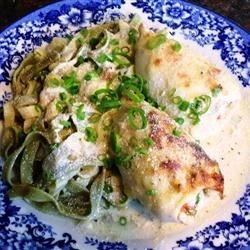 Absolutely Delicious Stuffed Calamari Recipe - Calamari tubes are stuffed with seafood and baked in a rich cream sauce before serving over a bed of linguine. This is probably the best calamari, if not the best entree, you'll ever have!