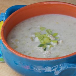 Celery and Stilton Soup Recipe - Onion and celery soup is pureed with Stilton cheese and served hot with a crumbling of cheese and a sprig of watercress.