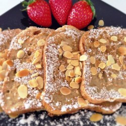 Vegan French Toast Recipe - Soy milk and nutritional yeast are the base for this vegan French toast recipe that is quick and easy to prepare.