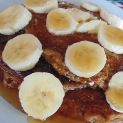 Banana-Oat Cottage Cheese Pancakes Recipe - These cottage cheese pancakes are sweetened with banana and brown sugar. Use a blender to get the batter done in a jiffy.
