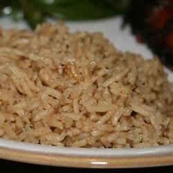 Brown Rice Recipe - This robust rice is the perfect side dish to serve with any meat, or with vegetables. Long-grain white rice is baked with beef broth, French onion soup, butter, Worcestershire sauce, and basil.