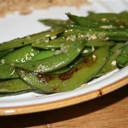 Sugar Snap Peas Recipe - Shallots and a little thyme are sprinkled over irresistible sugar snap peas!