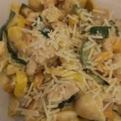 Pasta with Mushroom and Zucchini Sauce Recipe - Mushrooms, zucchini and onion are finely chopped then stewed with butter and garlic until tender.  Cream is added at the last minute for a rich vegetarian sauce.