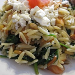 Elegant Orzo with Wilted Spinach and Pine Nuts Recipe - Orzo pasta with wilted spinach, feta cheese, tomatoes, and balsamic vinegar - goes well with fish or chicken.