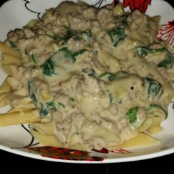 Artichoke Spinach Pasta Sauce Recipe - This rich and creamy artichoke and spinach pasta sauce combines Alfredo sauce, mozzarella cheese, Parmesan cheese, and cream cheese. Serve with your favorite pasta.