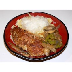 Chicken Pepperoncini Recipe - Chicken is breaded and fried, then mixed with mushrooms, onion and pepperoncini peppers in a delicious dish ideally served over rice. Add or subtract the number or pepperoncini peppers used to suit your taste.
