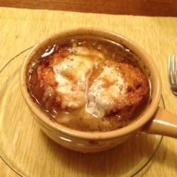 American French Onion Soup Recipe and Video - This French onion soup is made with sweet caramelized onions, rich cheese, and an American twist that makes this classic an easy and delicious recipe for a rainy day.