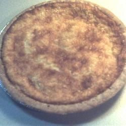 Lauriee's Coconut Custard Pie Recipe - This lovely recipe makes two pies, so it 's perfect for delighting a small crowd. And it couldn't be easier. Eggs, sugar, evaporated milk, vanilla, cornstarch and butter are stirred together, poured into waiting crusts, sprinkled with coconut, and baked.