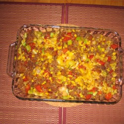 Chili Casserole Recipe - Red taco sauce is used in this casserole of browned ground beef combined with celery, corn, and tomatoes. It is baked with egg noodles and topped with cheese.