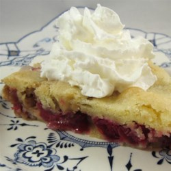 Cranberry Nut Pie Recipe - A crust-less cranberry and walnut pie that can be whipped out in a jiffy. The perfect partner for a scoop of vanilla ice cream.