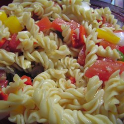Italian Pasta Veggie Salad Recipe - Tri-color corkscrew pasta makes a colorful salad along with the green peppers and red, red tomatoes. And it 's fat-free. Serves eight.