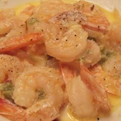 Spicy Shrimp in Cream Sauce Recipe - Shrimp in a spicy cream sauce to be served as an appetizer with hot-baked French bread (for dipping), or over fettuccini (as a not-so-light meal).  Fun to prepare in front of guests as a prelude to a nice seafood dinner! Use any hot pepper you like, Cajun seasoning, or even hotter!