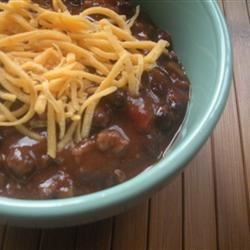 Fantastic Black Bean Chili Recipe - This hearty black bean chili has ground turkey, is flavored with chili powder, oregano and basil, and perked up with a spoonful of red wine vinegar.