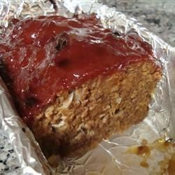 Cottage Meatloaf Recipe - Meatloaf made with a hint of red pepper and tangy tomato juice, glazed with ketchup, mustard and brown sugar.