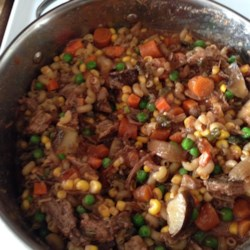 Cheapskate Stew Recipe - This is a hearty beef and macaroni stew to make with ground beef and leftover vegetables.