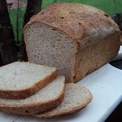 Honey Multigrain Bread Recipe - Two loaves of hearty bread containing cornmeal, whole wheat and rye flour.