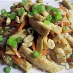 Chicken Honey Nut Stir Fry Recipe - This healthy stir fry features a sweet, spicy citrus sauce over chicken, carrots and celery and a garnish of cashews.