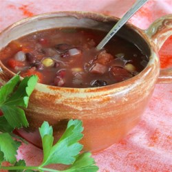 Three Bean Soup Recipe - Kidney beans, lentils, and garbanzo beans are stewed with tomatoes and spiced with oregano and pepper.