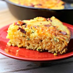 Cheesy Bacon Jalapeno Skillet Cornbread Recipe - Gluten-free skillet cornbread just got fancy with the addition of bacon, jalapeno peppers, and pepperjack to the batter.