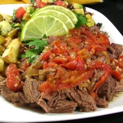Colombian Stewed Flank Recipe - Flank steak is simmered for 2 hours in a delicious stew with onions, tomatoes, and garlic.