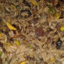 Orange Wild Rice with Pistachios and Cranberries Recipe - Dried cranberries and pistachios are added to wild rice that has a mild orange flavor to create this hearty and easy dish.