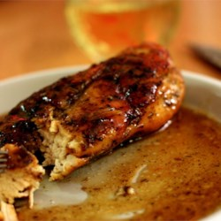 Rosemary Chicken with Orange-Maple Glaze Recipe - Chicken breasts adorned with a fresh rosemary rub, then sauteed and braised in a sauce of orange juice, white wine and maple syrup. This wonderfully rich glaze makes an elegant, quick dinner to serve to guests. To serve, place chicken on top of hot cooked rice on each plate and spoon sauce over the top. Wonderful served with steamed asparagus.