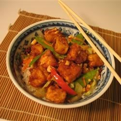 Tofu Peanut Stir-Fry Recipe - This is absolutely the best way to eat tofu: it has a slightly crunchy exterior while the inside is nice and soft. My 2-year-old loves it! It is a delicious, easy, quick, and inexpensive meal. Serve with Asian noodles or steamed rice.
