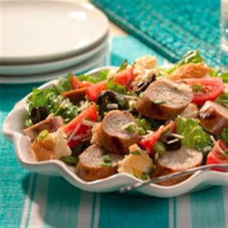 Sweet Italian Chicken Sausage Panzanella Recipe - The addition of grilled Italian-style chicken sausage makes this traditional green salad with crusty bread chunks a delicious main dish.