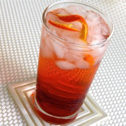 Americano Cocktail Recipe - American tourists in Italy popularized this refreshing Campari(R) and sweet vermouth cocktail. It's a Negroni, basically, minus the gin octane. Nice for afternoon sips at a cafe in Rome. Or even in Topeka.