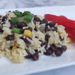 Black Beans and Rice Recipe and Video - White rice, garlic and onion is cooked in a nice vegetable stock for about 20 minutes. Black beans, cayenne and cumin are added to the pot, given a stir ...and that's it. Black Beans and Rice for six.