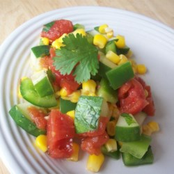 Mexican Cucumber Salad Recipe - Cool summer vegetables and warm spices make for a colorful, zesty salad!