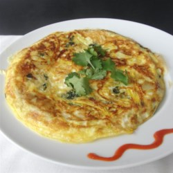 Squash Zoodler Omelet Recipe - Zoodled squash is cooked with spinach and cilantro and topped with egg and mozzarella cheese for a quick and easy omelet.