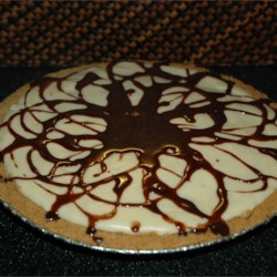Chocolate Caramel Nut Pie Recipe - First cook up a very creamy and rich fudge layer using two kinds of chocolate -semi-sweet and unsweetened. Then pour it into a graham cracker crust and bake. Add a cream cheese layer and bake again, and then top the pie with milk chocolate cream drizzled over the top.