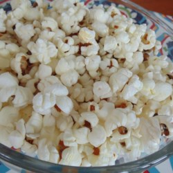Coconut Oil Popcorn Recipe - Coconut-oil popcorn with sea salt is a perfect and delicious snack alternative to traditional oil-popped popcorn.