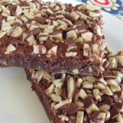 "Laura's ""Thin Mint"" Brownies Recipe - Adding a wonderful mint layer to classic brownies, this easy-to-make recipe is sure to surprise and delight."