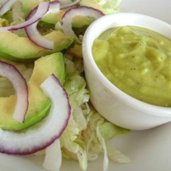 Avocado Salad with Avocado-Lime Vinaigrette Recipe - Avocados, red onion, and lettuce are tossed together with a simple avocado-lime vinaigrette to make this delicious and tangy salad.