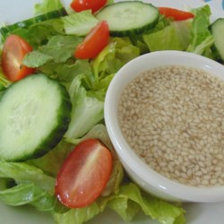 Sweet and Sour Sesame Seed Salad Dressing Recipe - Onion juice and toasted sesame seeds flavor this sweet and tangy salad dressing.