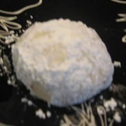 Butter Balls II Recipe - The recipe for butter ball cookies calls for butter, sugar, flour, and pecans - roll the cooled cookies in confectioners' sugar and you're done!