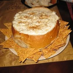 Joelle's Famous Hot Crab and Artichoke Dip Recipe - A very rich and spicy crab dip with artichokes and white Cheddar cheese.  Served in a sourdough bread bowl.