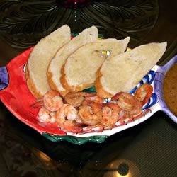 New Orleans Barbequed Shrimp Recipe - This is a sure winner in any home. Be sure and cover the table with old newspapers to gather the shells and make clean up easy.  Make sure to have warmed French bread to dunk in the 'sauce'!  Bibs would be nice to protect your clothing from the sauce but not necessary.