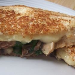 Grilled Mushroom and Swiss Recipe - Dress up a traditional grilled cheese sandwich with fresh mushrooms and baby spinach.
